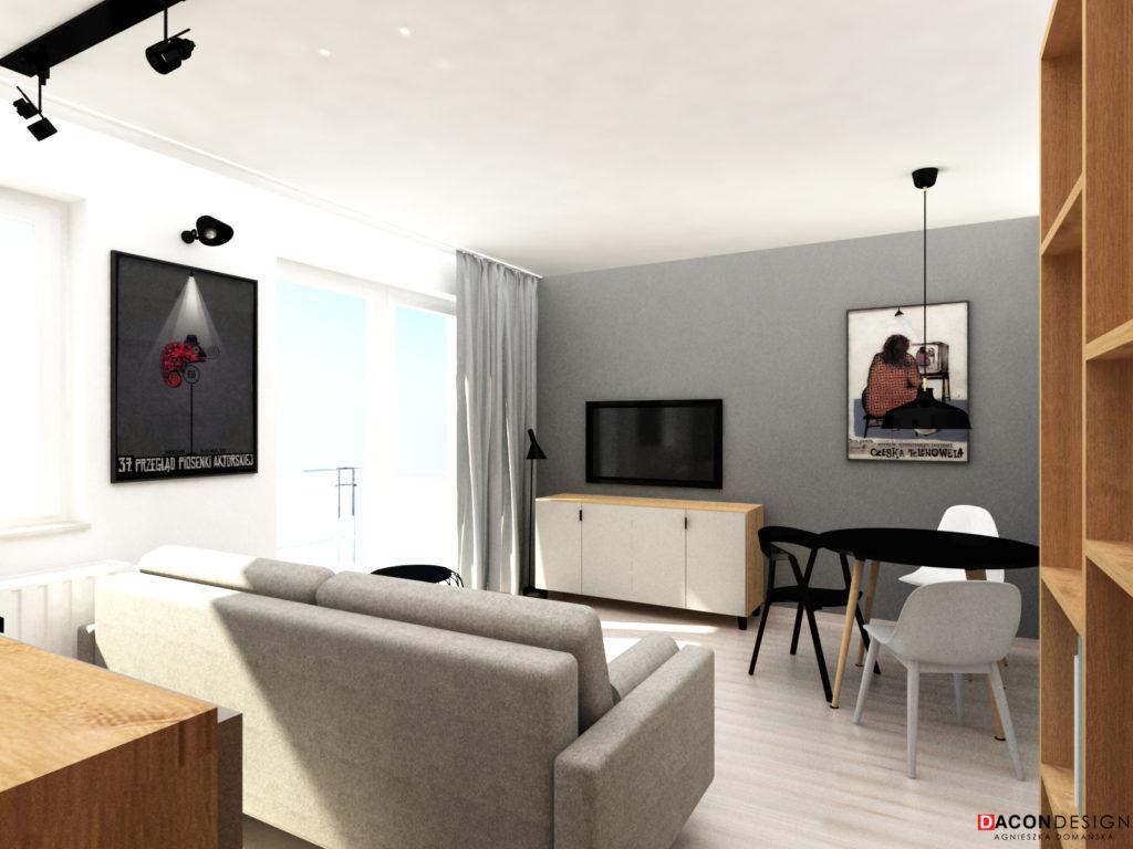 Salon z meblami Vox, szarą sofą rozkładaną z salonów Agata Meble oraz grafikami Ryszarda Kai