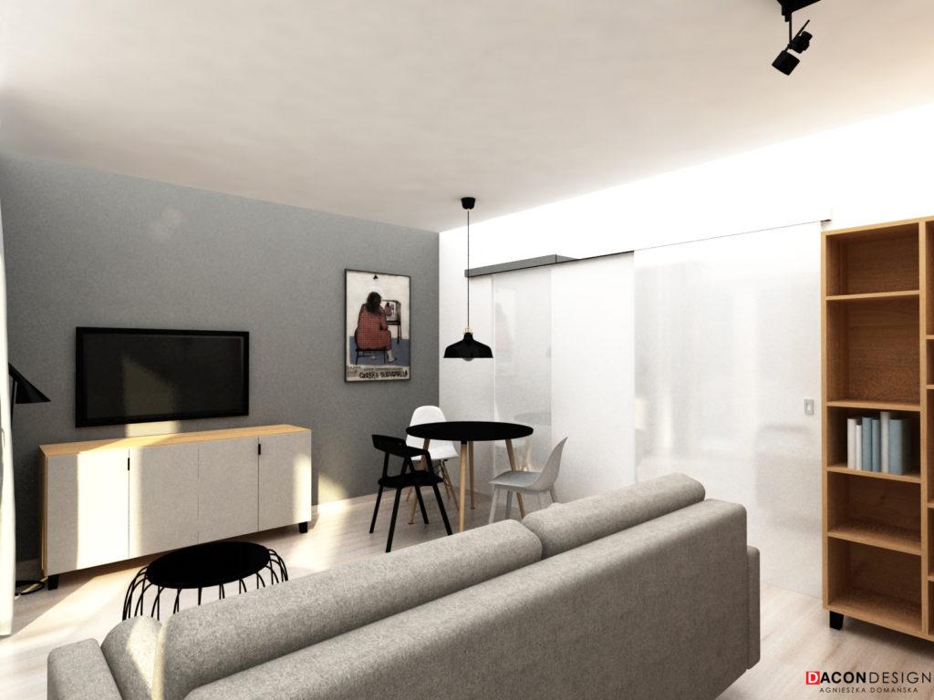 Mieszkanie dla singla w nowczsenym stylu z sofą Agata Meble, meblami marki Vox i grafikami Ryszarda Kai