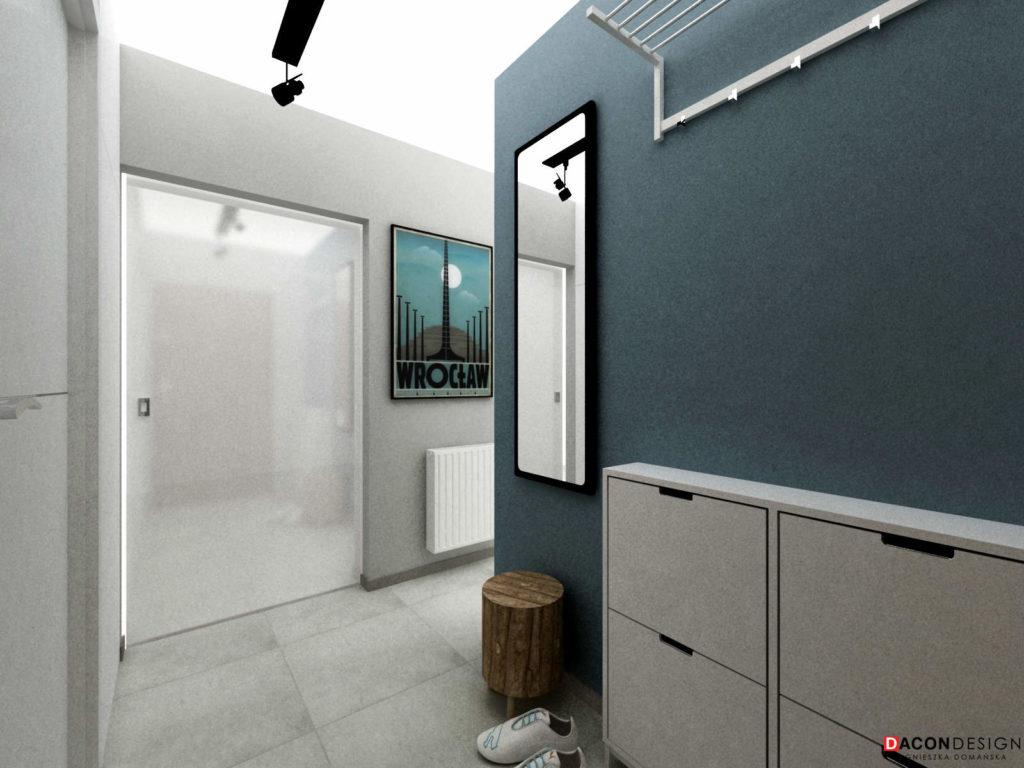 Aranżacja przedpokoju w nowoczesnym stylu z niebiską ścianą i meblami Ikea