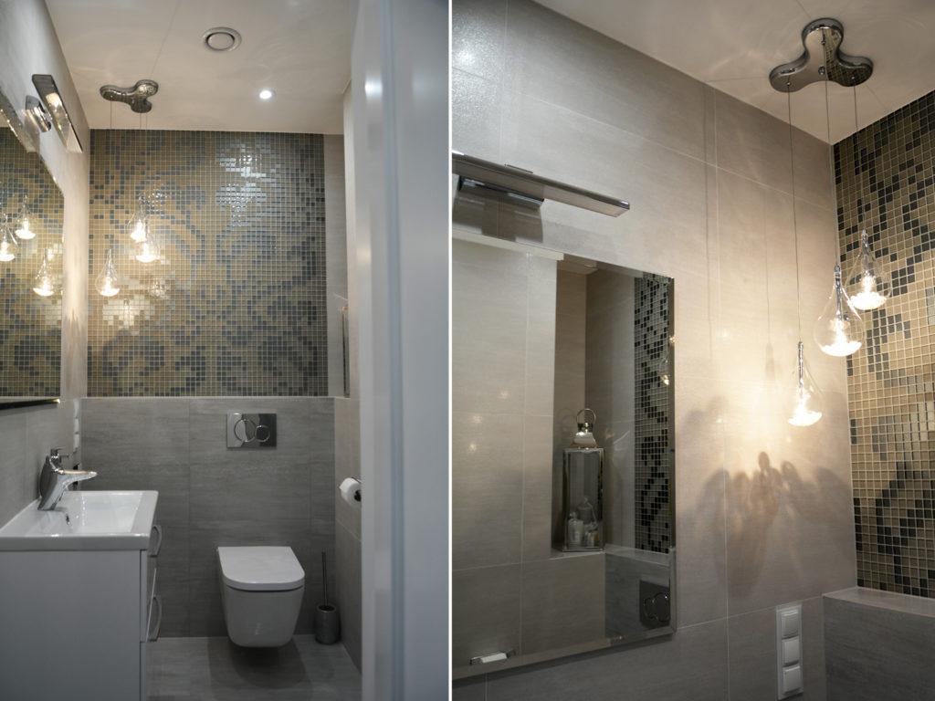 Nowoczesna łazienka z mozaiką i aramaturą marki Roca, wiszącym lampami szklanymi z kryształkami