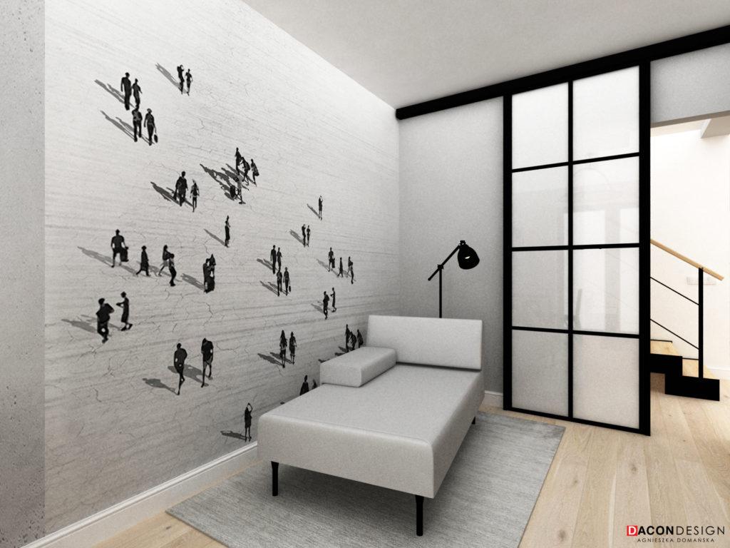 Szara leżanka projektu Kuchcińskiego oraz tapeta na ścianie głównej pokoju do pracy