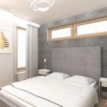 Ściana z szarej cegły w sypialni