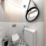 Mała toaleta w skandynawskim stylu z płytkami metro i płytkami we wzory