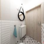 Lustro na psku skórzanym oraz mała szafka z umywalką Roca w toalecie