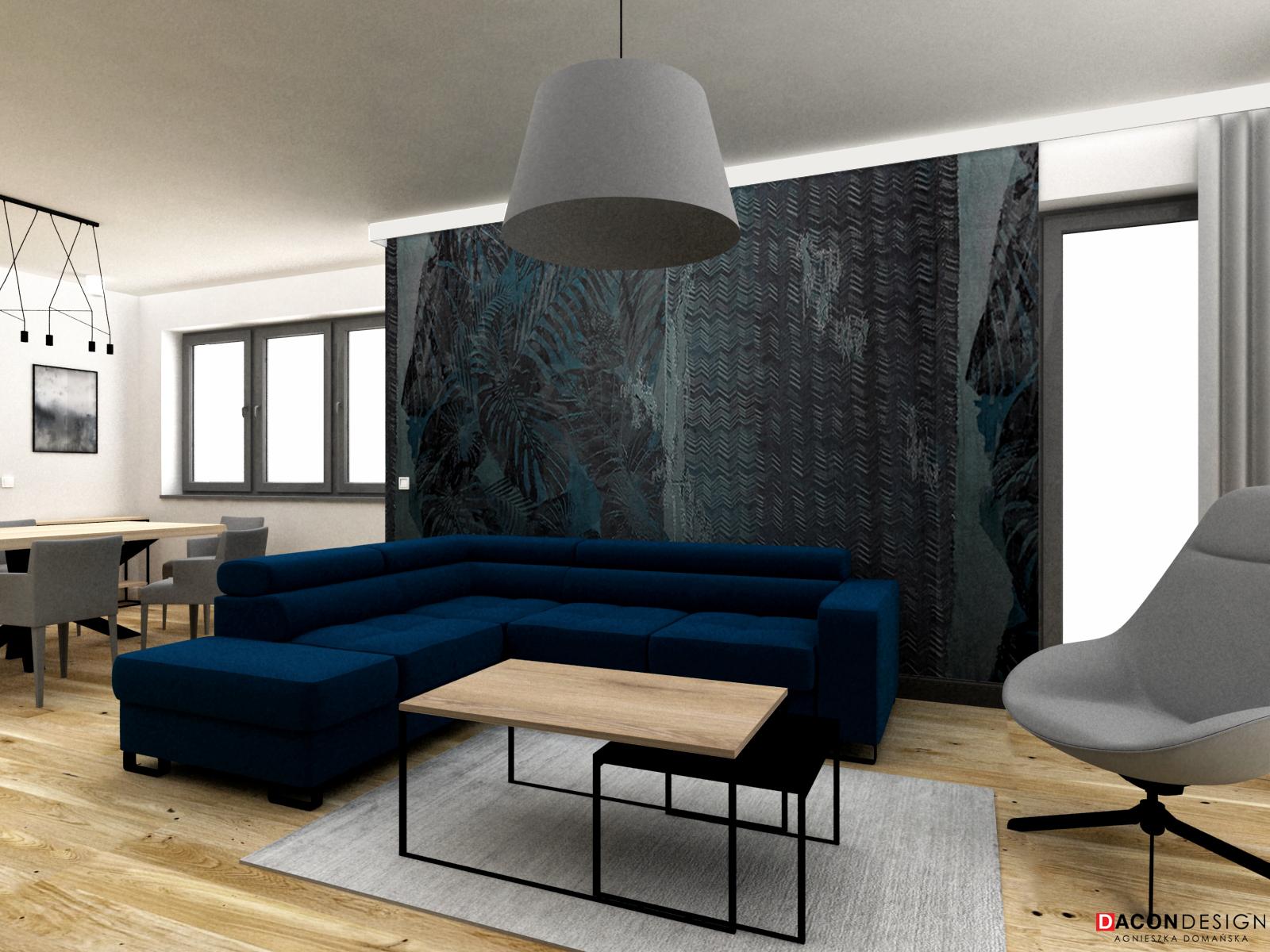 Minimalistyczny salon z niebieską tapetą, stolikiem kawowym z metalu i drewna oraz dywanem.